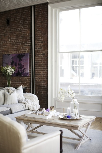 Loft afrancesado en NYC - salon y pared de ladrillo